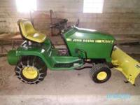 John Deere LX178 Lawn Tractor, with snow blade, chains