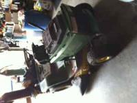 For sale is a 1995 john deere lawn tractor with a water