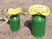 I have 2 John Deere Milk cans with cultivator seats on