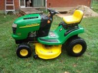 John Deere riding mower like new condition, New engine