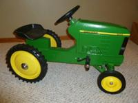John Deere 7410 pedal tractor from Ertl.  It is mint