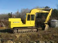 Johndeere 690B excavator with thumb attachment ()