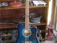 Johnson 6-string thin body acoustic guitar.  The guitar