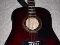I HAVE A JOHNSON ACOUSTIC GUITAR WITH CASE FOR SALE IN