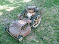 Old johnson big wheel mower 5hp runs well. Plus extra