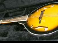 Nice - clean Johnson Mandolin with case See it at Cash
