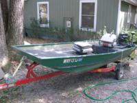 Jon boat with a mercury four stroke motor it has a 3