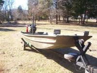 15' Jon boat with 23hp long tail mud motor. Boat is in