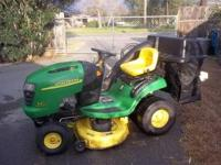 A john deere riding lawnmower .It has 86.3 hours and