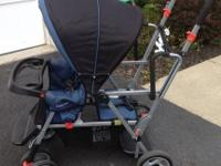 Blue & Black Joovy Caboose Stand-On Tandem Stroller.
