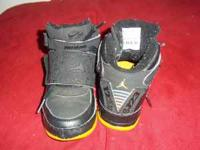Size 10.5c black and yellow Jordans still in good