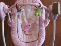 Adorable pink baby Just One Year brand swing makes a