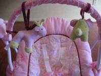 This adorable pink baby bouncer is a great gift for