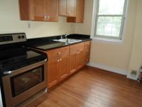 Move in now, June is free. Kitchen with new cabinets,