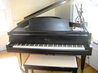This is a beautiful K. Kawai Grand Piano 5' which is