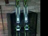 These skis have been used about 8 days. They are in