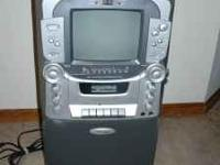 Used Karaoke machine with no microphone. Purchased a