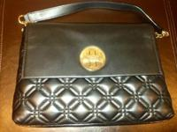 Cross stitched quilted cowhide leather purse. 14-karat