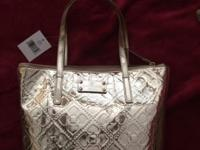 Brand new gold Kate Spade tote This ad was posted with