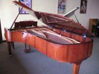 This is a gorgeous Nine-foot Grand Piano with a rare