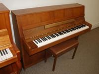 ON SALE! This Kawai console is a lovely piano. Kawai is