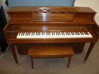 Walnut Kawai Console. Kawai pianos are distinguisheded