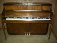 Kawai Console Upright Piano with a matching bench,