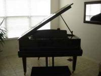 This KAWAI K10 Grand Piano has almost no playing time.