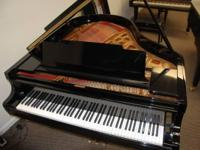 This is a beautiful Kawai grand piano, model KG-2C,