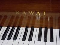 MAKE: KAWAI.  DESIGN: KL-702.  FINISH: LIGHTING WALNUT