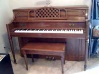 This is a beautiful upright piano. Was last tuned in