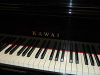 "We have a lovely 52"" upright Kawai Piano black gloss"
