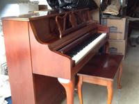 $900. Kawai Piano. Cherry finish. Excellent condition.