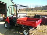 Model 2010, 4 wheel drive, electric hyd dump, runs
