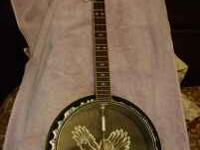 Kay banjo in excellent condition. Call  after 4pm for