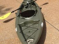 The kayak is a Pelican, 11.6 feet (normally called a