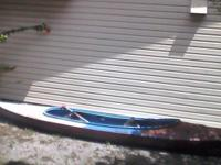 Kayak for sale two seater with two paddles. Needs paint