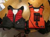 Two life vest for sale $50.00 each. The red one in the