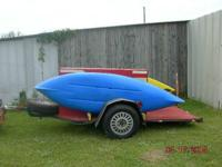 10' kayak trailer that has center storage space area. 3