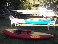 "The blue and white kayak is fiberglass is 10""2"" long -"
