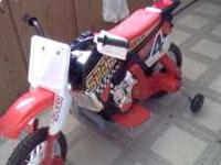 Red battery operated dirt bike,needs charger(about 30