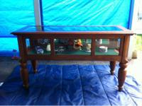 I have a nice Keller Furniture glass display case. It
