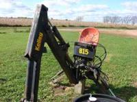 Kelly backhoe hooks up to 3 point on back of tractor,