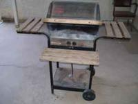 Kenmore Gas BBQ Grill. Needs a new Burner. Tel: