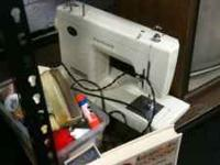 Kenmore sewing machine. Comes with extra thread,