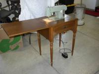 Sears Kenmore sewing machine in cabinet. Model #2142