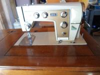 Kenmore Sewing Equipment w/table (Electric - runs).