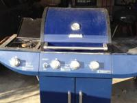 Blue, has 3 grill burners and 1 cook top burner in good