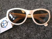 Kenneth Cole Reaction Sunglasses in Cream priced at