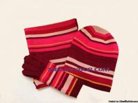 Show your stripes with this Kensie sparkling scarf, hat